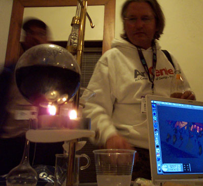 Bruce Sterling, his brandy still, and his Powerbook playing a Bollywood film